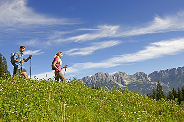 Hikers on Hausberg mountain, Hartkaiser, View towards Wilder Kaiser, Tyrol, Austria