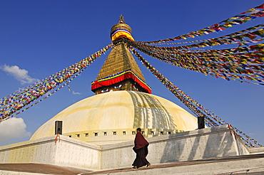 Buddhist monk at Bodnath Stupa, Kathmandu, Kathmandu Valley, Nepal, Asia