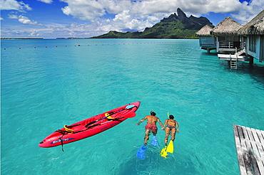 Couple snorkelling, Saint Regis Bora Bora Resort, Bora Bora, Society Islands, French Polynesia, Windward Islands, South Pacific