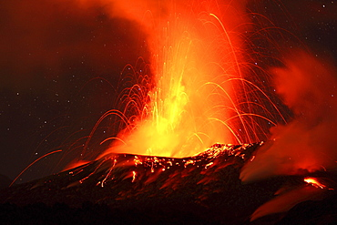 Red hot lava and sparks erupting from the Tavurvur Volcano at night, Rabaul, East New Britain, Papua New Guinea, Pacific