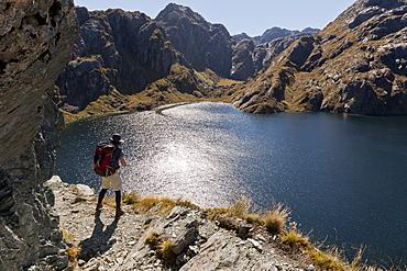 Hiker on the Routeburn Track at Lake Harris, Great Walk, Mount Aspiring National Park, Fiordland National Park, South Island, New Zealand