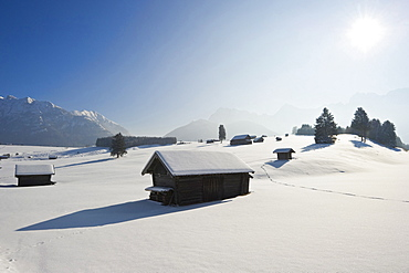 Snow covered huts near Mittenwald, Bavaria, Germany