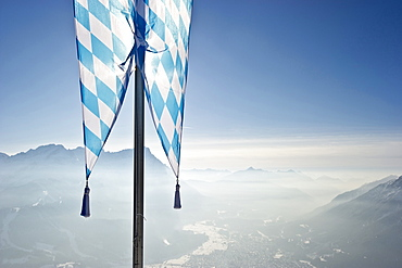 Bavarian flag on the Wank mountain, Zugspitze in the background, Garmisch-Partenkirchen, Bavaria, Germany