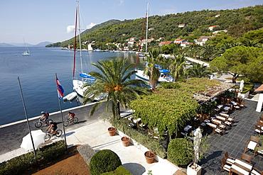 Terrace of hotel restaurant at the natural harbour, Hotel Sipan, Sipanska Luka, Sipan island, Elaphiti Islands, northwest of Dubrovnik, Croatia