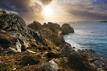 Breathtaking sunset light above the Crozon Peninsula on an unsettled day in spring with the Island Pointe de Penhir in the background, Brittany, France