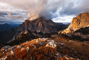 Dramatic atmosphere above the southern Fanes nature park in the Dolomites with the view to Piz dles Conturines in last sunlight, Belluno, Italy