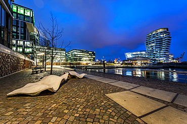 Twilight at Marco-Polo-terrace and Marco-Polo-tower at Hafencity, Hamburg, Germany
