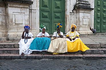 Four Brazilian women in traditional Bahian costumes in the Pelourinho old town district, Salvador, Bahia, Brazil