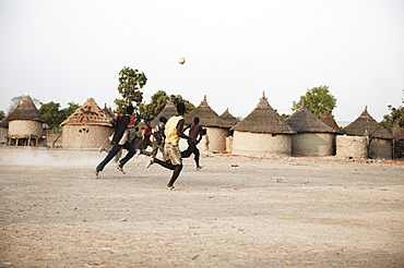 Boys playing soccer, Magadala, Mali