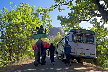 Elephant with tourists passing bus at Sigiriya, Matale Distict, Cultural Triangle, Sri Lanka, South Asia
