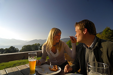 Couple in a beer garden near Lake Tegernsee, Near Gmund, Upper Bavaria, Bavaria, Germany