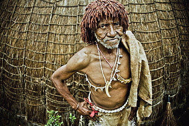 Traditional healer of a Swazi village in front of his grass hut, Swaziland, Africa