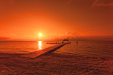 Beach with landing stage in the morning light at sunrise, Moorings Village Resort, Islamorada, Florida Keys, Florida, USA