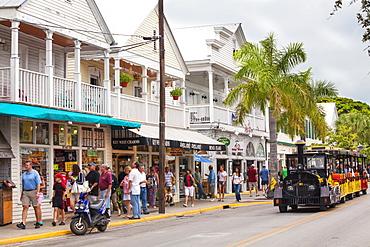 The Conch Tour Train on the main shopping street, Duval Street, Key West, Florida Keys, USA