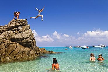 Children jumping off rocks into the sea, Marinella beach, Marina di Zambrone, Tyrrhenian Sea, Calabria, Mediterranean, Southern Italy, Europe - 1113-98163