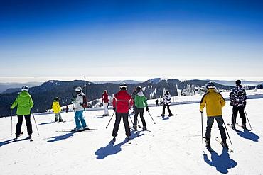 Skiers on the summit of Feldberg, Black Forest, Baden-Wuerttemberg, Germany