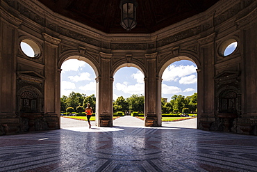 Young woman jogging through Dianatempel, Hofgarten, Munich, Bavaria, Germany