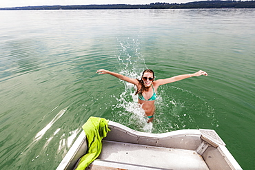 Young woman bathing in lake Starnberg, Bavaria, Germany