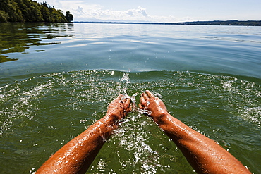 Man swimming in lake Starnberg, Bavaria, Germany