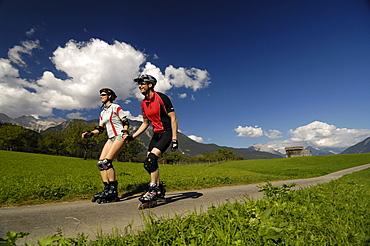 Couple on inline skates, Inline skating, near Imst, Tyrol, Austria