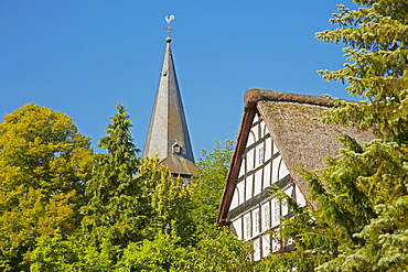 Church tower of the Roman church from about 1200 and thatched house at Mehren near Altenkirchen, Westerwald, Rhineland-Palatinate, Germany, Europe