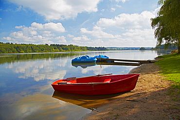 Pond with boats, Dreifelder Weiher, Westerwaelder Seenplatte, Westerwald, Rhineland-Palatinate, Germany, Europe