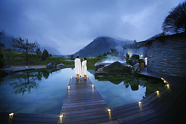 Hotel guests on a jetty at a natural source pond, Tannheim, Tannheim Valley, Tyrol, Austria