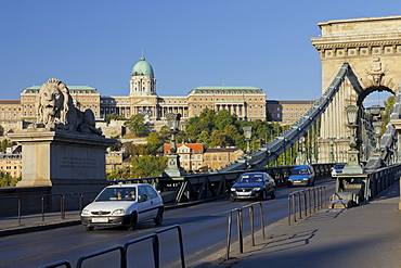 Lionstatue and traffic on the Chain Bridge, Buda Castle, Budapest, Hungary