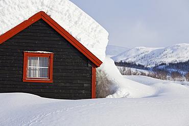 Snowy hut in a winter landscape, Kvanndalen, Hordaland, Norway
