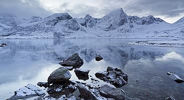 Fjord with reflection of mountains in the water, Stortinden, Flakstadpollen, Flakstadoya, Lofoten, Nordland, Norway