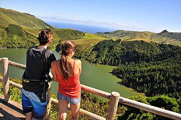 Young couple enjoying the view, Caldeira Funda, Island of Flores, Azores, Portugal