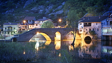 Stone bridge, Stari Most at dusk, Rijeka Crnojevica, Lake Skadar National Park, Montenegro, Western Balkan, Europe