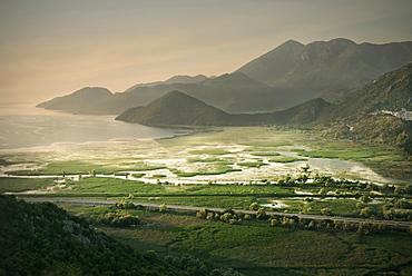 Dramatic morning light with view of Virpazar, the lake and mountains, Lake Skadar National Park, Montenegro, Western Balkan, Europe