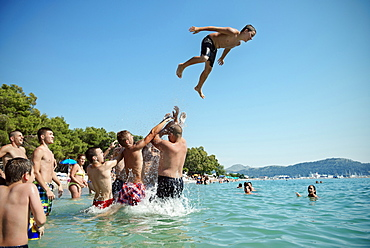 Young people splashing around in the sea, beach at Bar, Adriatic coastline, Montenegro, Western Balkan, Europe