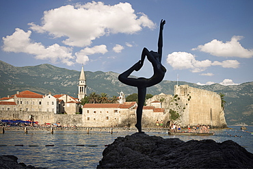 Sculpture of a nude female acrobat in front of the old town of Budva, Stari Grad, Adriatic coastline, Montenegro, Western Balkan, Europe