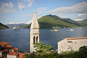 View of Perast with church tower, cruise ship in the background, Island of St. George and Our Lady of the Rock island, Bay of Kotor, Adriatic coastline, Montenegro, Western Balkan, Europe, UNESCO