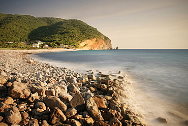 Surf on a rocky beach in Petrovac near Budva, Adriatic coastline, Montenegro, Western Balkan, Europe, long time exposure