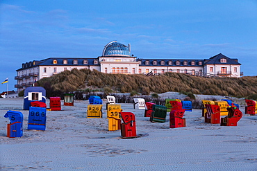 Spa Hotel at dusk, beach chairs, Juist Island, Nationalpark, North Sea, East Frisian Islands, East Frisia, Lower Saxony, Germany, Europe
