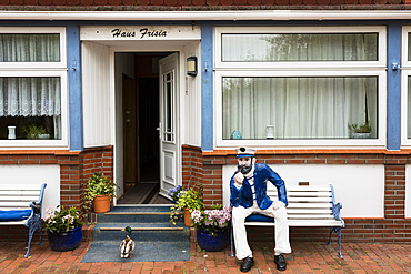 Seafarer and duck in front of a frisian house, Juist Island, Nationalpark, North Sea, East Frisian Islands, East Frisia, Lower Saxony, Germany, Europe