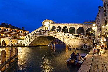 The Grand Canal with Rialto bridge at dusk, Venice, Venetia, Italy, Europe