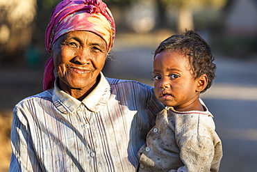 Old woman with child near Ampefy, highlands, Madagascar, Africa