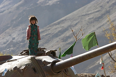 Girls playing on an abandoned Soviet tank in the Siagerd Valley, Parwan Province, Afghanistan