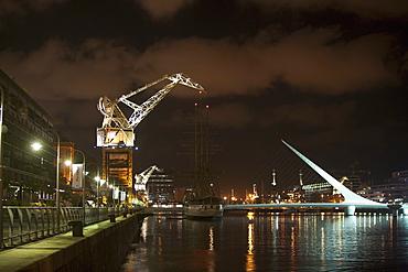 Santiago Calatrava's Puente de La Mujer (Women's Bridge) in Puerto Madero at night, Buenos Aires, Capital Federal, Argentina