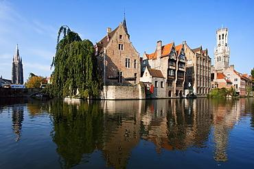 Medieval houses and Belfort (Belfry) reflected in a canal, as seen from Rozenhoedkaii, Bruges (Brugge), West Flanders, Belgium