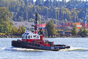 Tug boat on the Fraser River, New Westminster, British Columbia, Canada