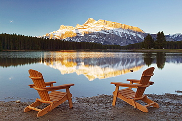 Muskoka Chairs in front of Mt Rundle and Two Jack Lake, Banff National Park, Alberta.