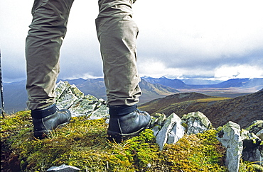 View of Hikers Boots Standing on a Mountain Ridge, Overlooking the Dempster Highway, Yukon