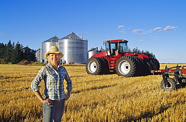 Farm Girl in front of Tractor, Dugald, Manitoba