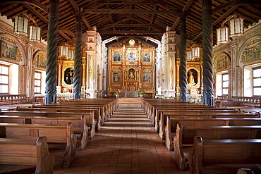 Nave and main altar with gilded and polychrome wood images carved in the Mestizo-Baroque style, Jesuit Mission of Concepcion, Santa Cruz Department, Bolivia