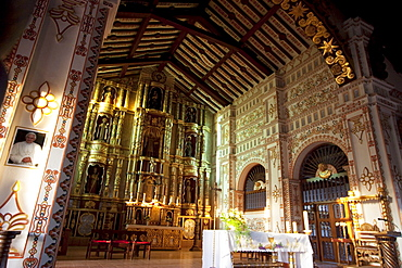 Main altar with gilded and polychrome wood images carved in the Mestizo-Baroque style, Jesuit Mission of San Ignacio de Velasco, Santa Cruz Department, Bolivia